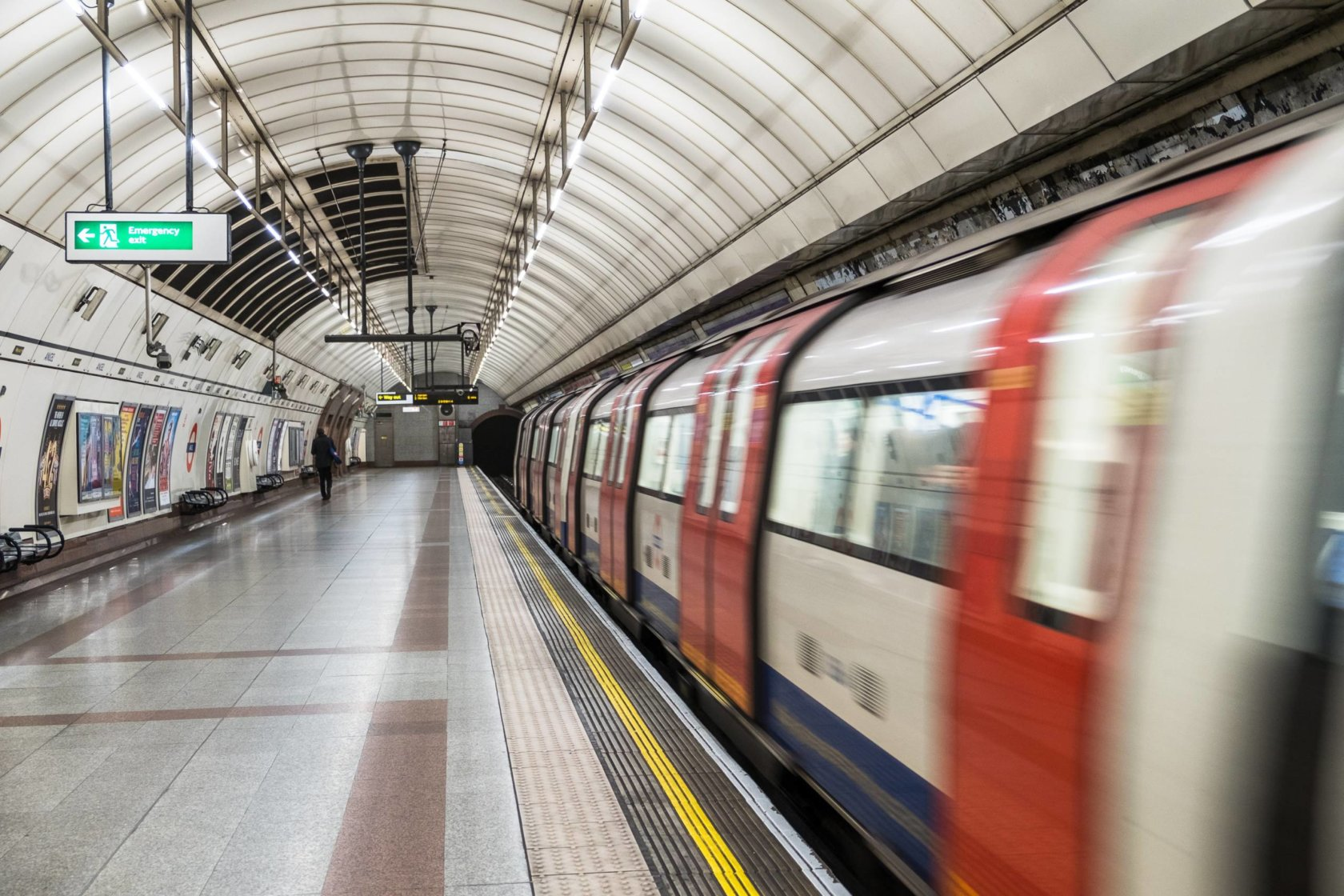 A motion photo of London's tube departing a station